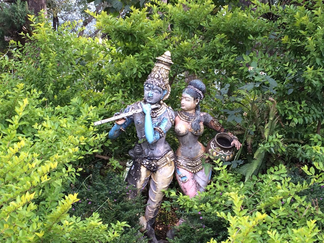 A garden statue of Radha and Krishna outside the estate office.